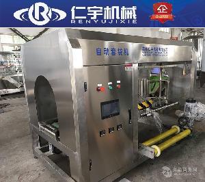 厂家直销全自动桶装水生产线 600桶全自动套袋机桶装水提桶套袋机